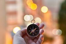 Closeup Of Hands Holding A Compass