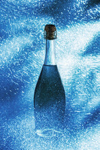 Fine Muscat Champagne Bottle Surrounded By Shiny Sparkling Lights And Placed On Blue Background