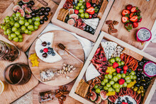 Top View Of Delicious Fresh Appetizers On Wooden Table Near Green Lush Shrub