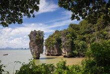 Picturesque View Of Rocky Steep Cliff And Rock Covered With Tropical Forest Washed By Calm Seawater Under Clear Blue Sky In Phuket Thailand