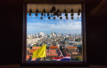 Spectacular Cityscape Of Bangkok With Contemporary Buildings From Window Of Famous Wat Saket Buddhist Temple Against Cloudy Blue Sky