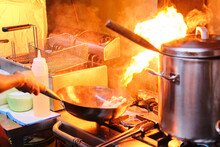 Stock Photo Of Unrecognized Chef Using Hot Saucepan In The Kitchen Of Japanese Restaurant.