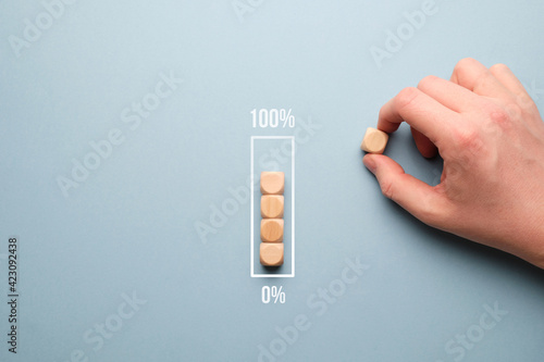 Fotografie, Obraz Zero to 100 percent loading bar concept with wooden cubes