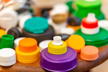 Detalhe De Tampas De Plastico Coloridas Separadas Para Reciclagem