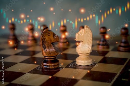 Chess horse with up and down of stock market in background. Fototapeta