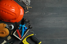 Concept Of Labor Day With Different Construction Tools On Dark Wooden Background