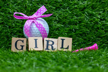 Golf Ball With Pink Ribbon For Baby Girl On Green Grass