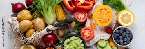 Fototapeta Selection of fresh raw vegetables, fruits and beans on light gray background. obraz