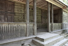 Empty Terrace With Closed Door And Window With Shutters On Traditional Ancient Russian Log Cabin Old Wooden House At Summer Day