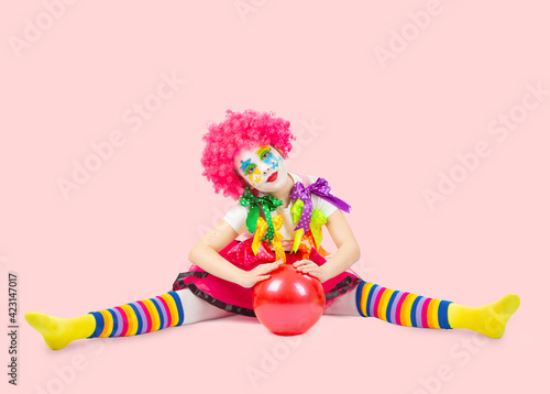 children in colorful clown outfits, isolated on a white background Fototapeta