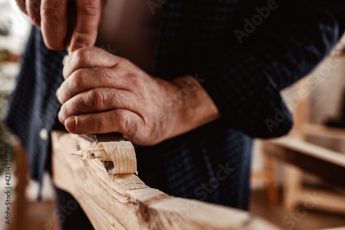 Fototapeta Hands of a carpenter working with chisel and hammer obraz