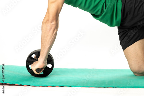 Fényképezés man with Ab roll Bodytone for abdominal strengthening