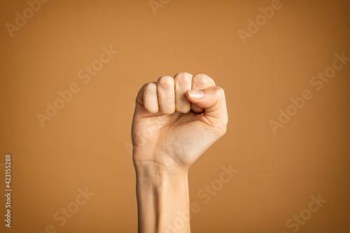 Fototapeta Woman hand making fist