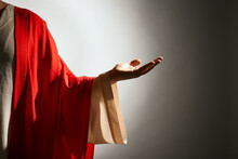 Jesus Christ Reaching Out His Hand On Grey Background, Closeup View