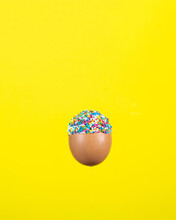 Egg Covered Halfway With Colorful Crumbs.stock Photo