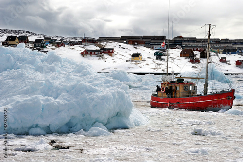 Canvas Fishing boats are breaking through icebergs in the Arctic Ocean.