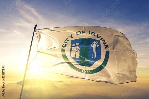 Obraz na plátne Irvine of California of United States flag waving on the top
