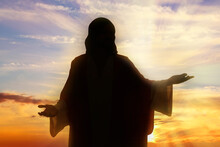 Silhouette Of Jesus Christ Outdoors At Sunset