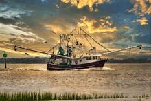 A Shrimp Boat Entering Charleston, SC Harbor In The Evening.