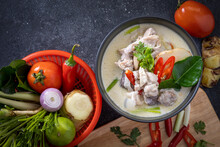 Chicken Tom Kha Put In Black Bowl On Wooden Table And Seasoning.