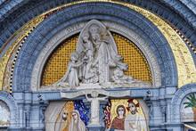 Detail Of The Sculptures Above The Entrance Doors To The Sacred Basilica Of Lourdes, Important Places Of Pilgrimage For The Catholic Religion