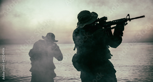 Canvas Print Commando soldiers walking in water, army special operations forces fighters snea