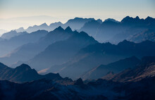 The View From Three Quarters Of The Way Up Mt. Huayna Potosi As The Morning Begins To Light The Valleys Behind The  Cordillera Real, Bolivia.