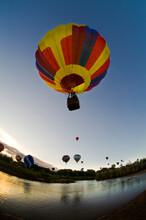 Balloons Soaring About Sandia Mountains And Rio Grande River During Albuquerque Balloon Fiesta