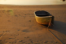 A Solitary Skiff Rests On The Beach In Late Afternoon, Ferry Beach, Scarborough, Maine