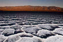 Salt Patterns At Dusk And Full Moon Light Over Badwater, -282 Feet Below Sea Level In Death Valley National Park, California.