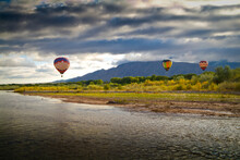 Balloons Soaring About Sandia Mountains And Rio Grande River During Albuquerque Balloon Fiesta