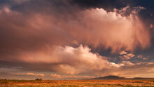 Scenic Image Of Storm Clouds At Sunset Over The Wetlands Of The Great Salt Lake And Antelope Island State Park, Utah.