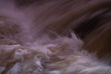 The Rushing Water Of The Waterfall