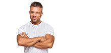 Handsome Muscle Man Wearing Casual White Tshirt Happy Face Smiling With Crossed Arms Looking At The Camera. Positive Person.