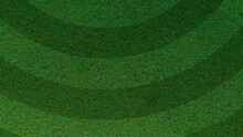 Green Grass Texture Background. A Perfectly Manicured Sports Field / Pitch / Garden Lawn Wallpaper With Circular Stripes.