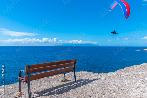 Photo Paraglider flying over Palomas viewpoint at Tenerife, Canary Islands, Spain
