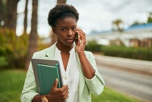 Young African American Businesswoman With Serious Expression Talking On The Smartphone At The City.