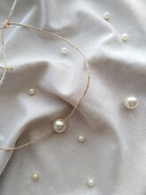 Light Pearls On Textile Background Wallpaper