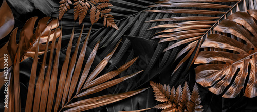 Obraz Creative nature background. Gold and green tropical Monstera and palm leaves. Minimal summer abstract jungle or forest pattern. - fototapety do salonu