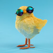 Easter decoration of a yellow chick wearing silly sunglasses.