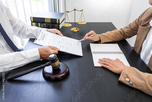Fotografie, Obraz lawyer or judge meeting with client consulting help discussing contract paper agreement
