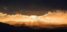 Spectacular Golden Sunset Over Long's Peak And The Front Range Of The Colorado Rocky Mountains As Seen Form Broomfield, Colorado