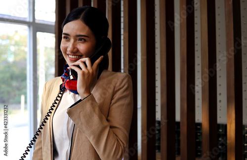 Slika na platnu Asia reception woman smile portrait in reception area at hotel.