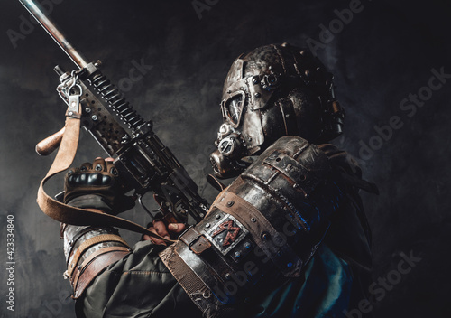 Canvas Print Survivor with custom armour and gun in dark background