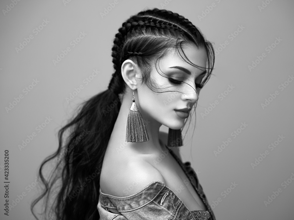 Fototapeta Brunette girl with perfect makeup. Beautiful model woman with curly hairstyle. Care and beauty hair products. Lady with braided hair. Model with jewelry. Black and white photo