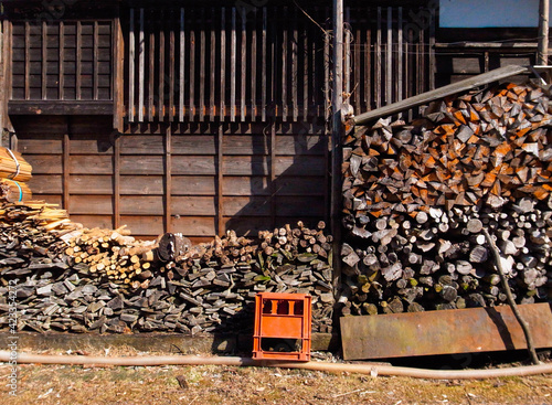Fotografija Pile of firewood behind japanese old house in the countryside.