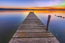 Stunning View From The Shore With A Wooden Pier