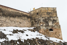 A Section Of A Medieval Fortification Wall Covered By Snow In Late Winter