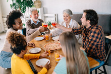 Multiethnic Diverse Extended Family Dining And Toasting Together