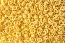 Italian Curly Pasta (Dischi Volanti) As A Background. Flying Saucer Shaped Pasta.